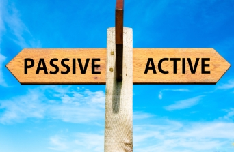 Wooden signpost with two opposite arrows over clear blue sky, Passive versus Active messages, Lifestyle change conceptual image